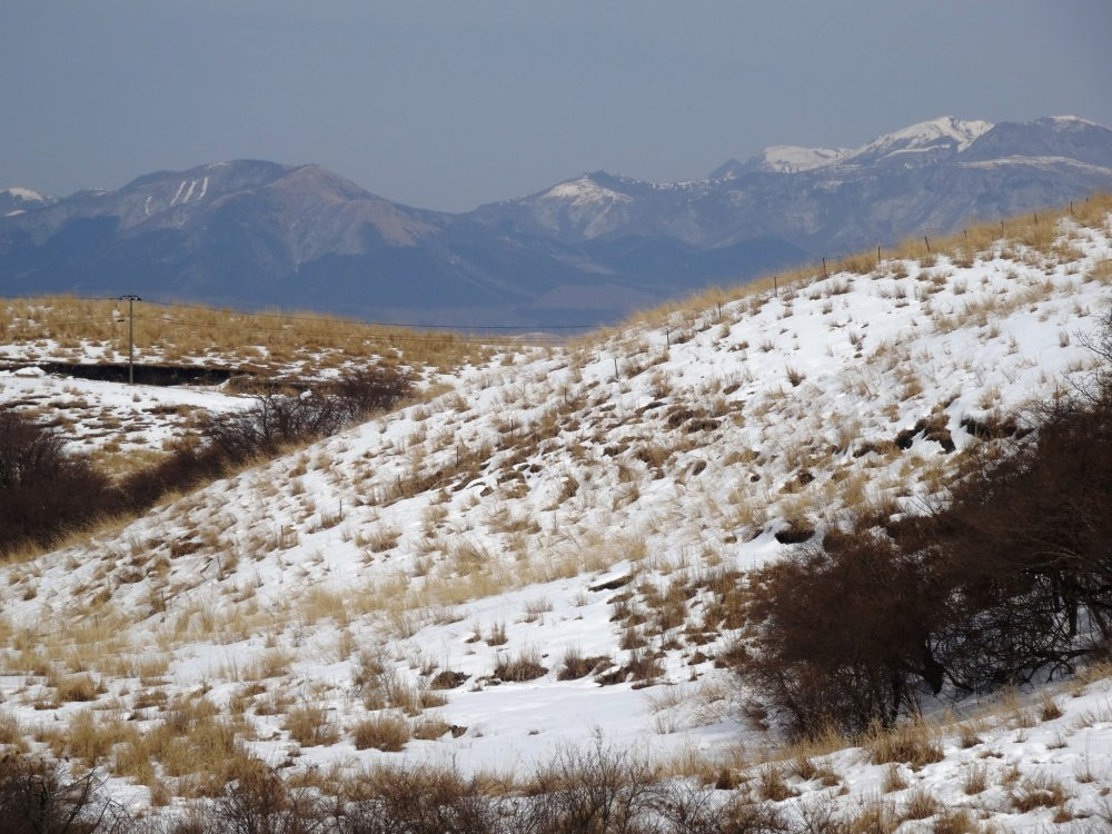 A view north to the snowy Kuju Mountains