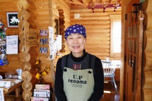 The owner of the cafe, Mrs. Ishizaka