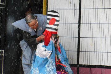 <p>A young child pulling off a Noh dance.</p>
