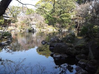 The garden is laid out around a peaceful pond