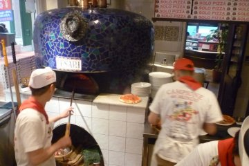 Staff hard at work cooking the perfect pizza