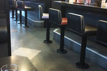<p>The interior is nice. You can sit at a counter or at tables.</p>