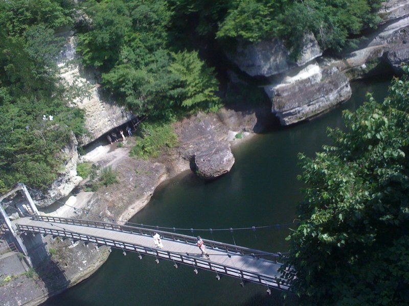 <p>The rather springy ropeway bridge over the river</p>