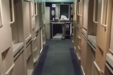 <p>The room with the capsules is separate from the bunks and other facilities</p>