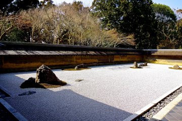 <p>The mysterious rock and sand garden of Ryoan-ji Temple</p>