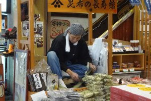 In front of one shop you might find a man demonstrating how they make slices of dried, shaved seaweed.