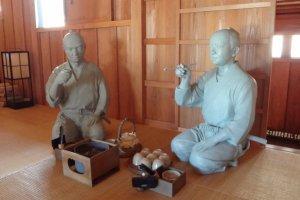 Officials having tea.