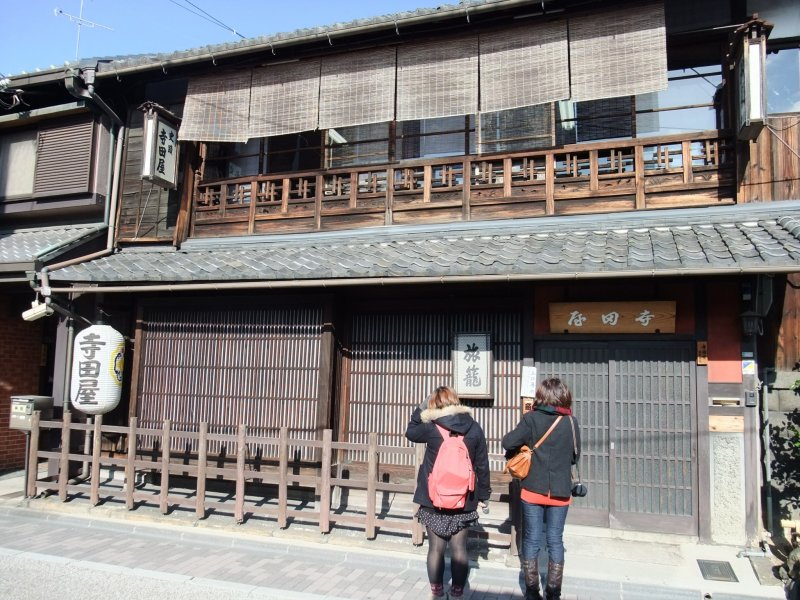 Front view of Teradaya Inn. Two young Ryoma fans are looking up at it