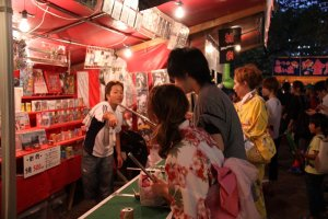 Girls clad in Yukata playing games