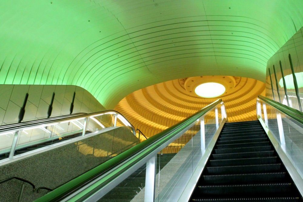 Ascending the Circular Hall by long escalators or staircases