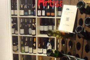 Brasserie Artisan has its wines in a room near the entrance behind a glass door.
