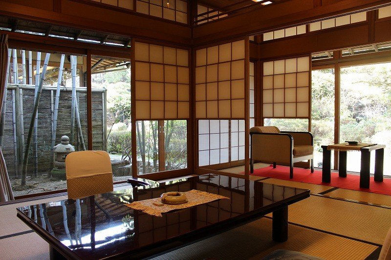 <p>A quiet garden provides a backdrop for the beautiful Japanese style room</p>