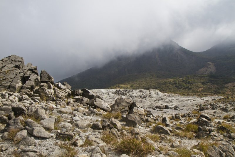 <p>A dark Mt. Karakuni&nbsp;as seen from the peak of Mt. Io</p>