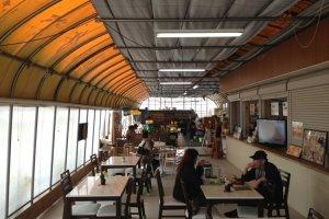 Customers enjoying snacks and coffee in Tado Green Farm cafe
