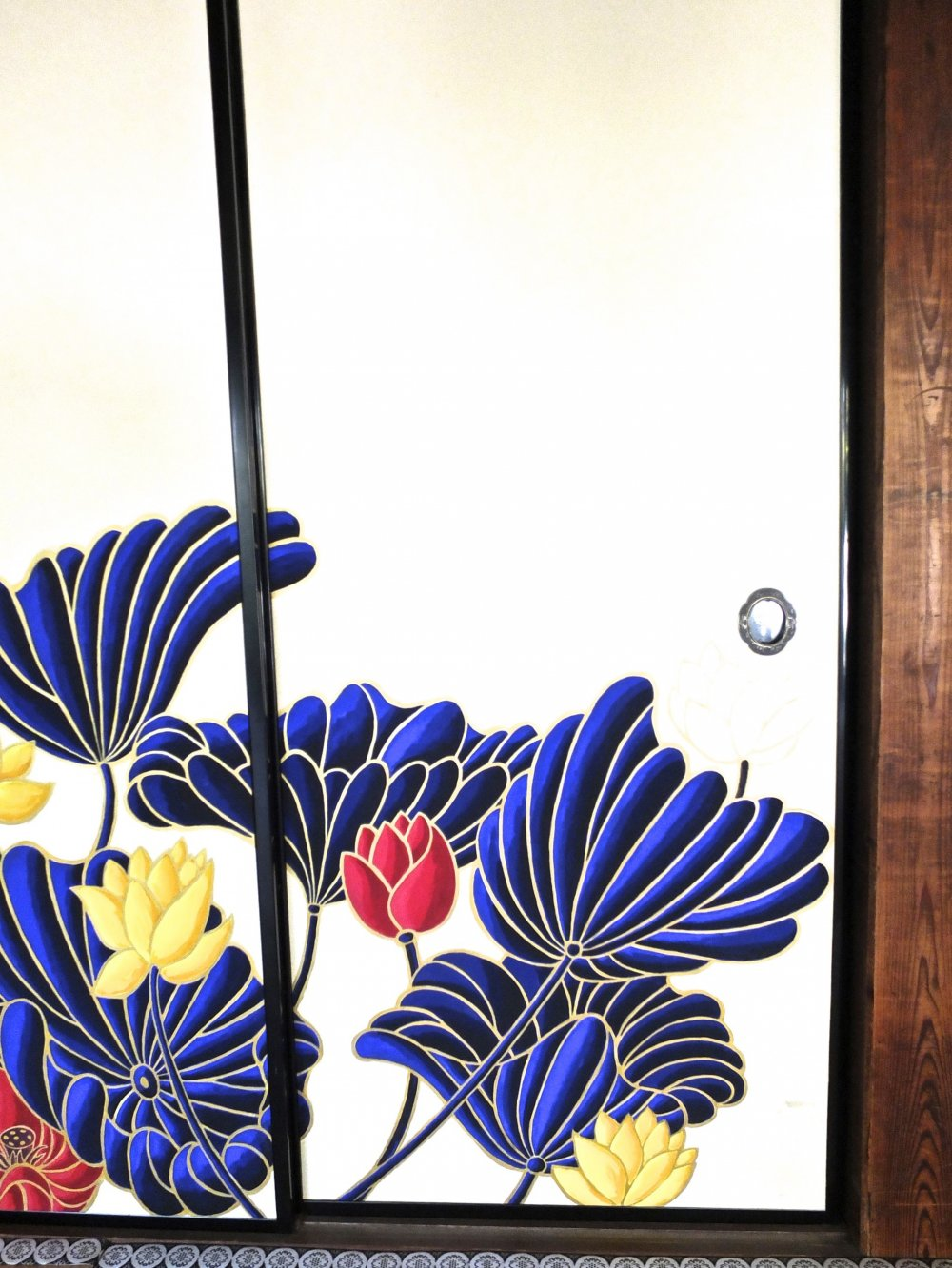 Many of the lotus are painted right onto sliding doors