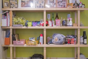 Shelf near the kitchen displaying different decorations.