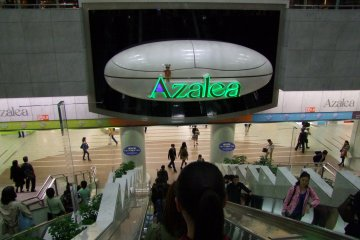 <p>The &quot;Azalea&quot; sign opens up and plays music every hour</p>