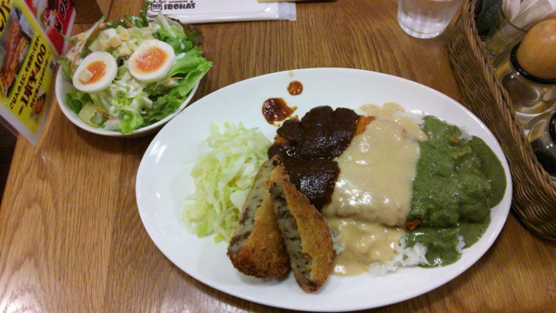<p>The triple katsumeshi, with white, red and green sauce, a croquette and a caesar salad, all delicious.</p>