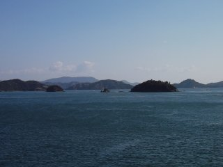 On the way to Naoshima we pass scores of forested islets