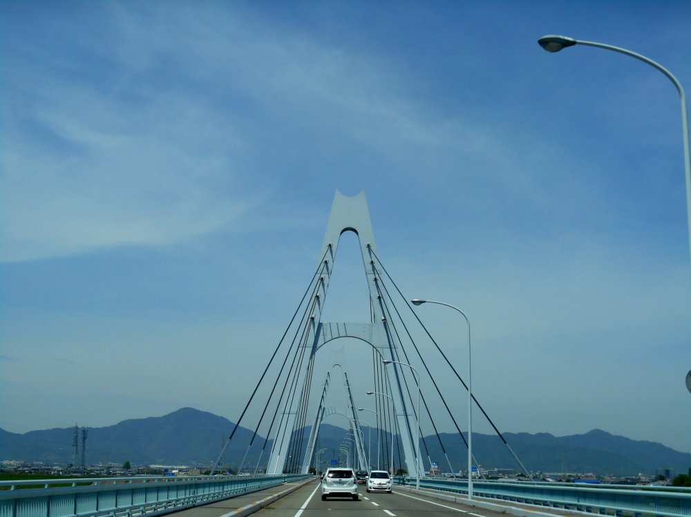 Crossing the Shikoku Saburo Bridge over the Yoshino River, on the way from Tokushima to Bando, where you can visit the Naruto German House and Bando POW Camp Site. This bridge, fairly new, was constructed in 1998.