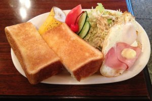 Thick Toast, Eggs, Ham and a salad with creamy sesame dressing.