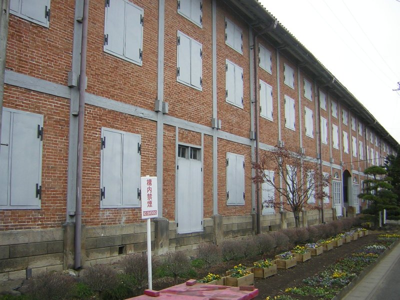 The outside of the warehouse is a mixture of timber and brick construction