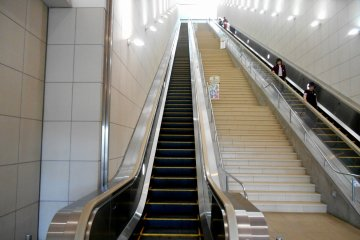 <p>Climbing up the long escalator to reach the entrance of Otuka Museum of Art</p>