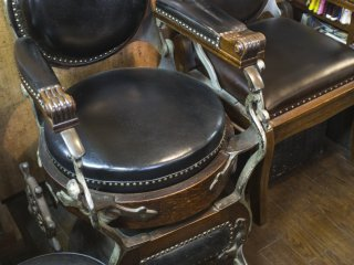 An antique Japanese barber chair made in 1916.