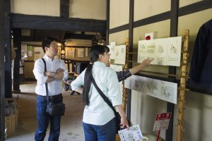 Explaining to visitors the steps of making washi paper.