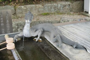 <p>If you enter Horyuji from the Minami-mon (Southern Gate), you can find this Chozuya (fountain used by visitors to &quot;purify&quot; hands before getting inside the temple). There are many&nbsp;chozuya in Horyuji and all are very particular and fascinating!</p>