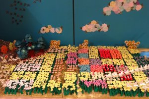 The field of flowers display which is filled with tiny origami flowers like tulips, daffodils, and more.