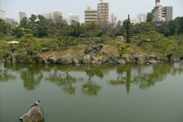 <p>Matsushima island in the pond has a distinctive tall pagoda</p>