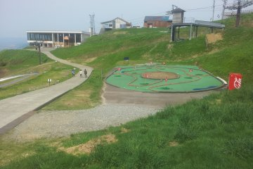 <p>Slide in the playground with cable car to GALA behind</p>