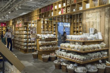 <p>The food section, separated by wooden shelves</p>