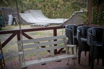 <p>Porch swing and skateboarding ramp</p>