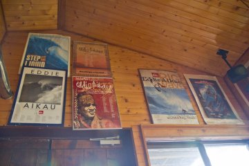 <p>Surfing posters decorate the wooden walls</p>