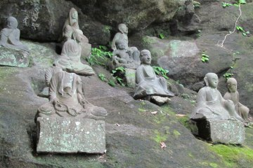 <p>Temple statues along the path</p>