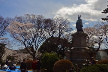 There is a big statue standing in the park. It is of Ii Naosuke who was a high-ranking samurai at the end of the Tokugawa Shogunate.