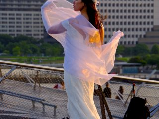 Model for a commercial shot posing against the Minato Mirai skyline