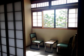 <p>Read a book or relax in the sun room in your mini apartment at&nbsp;Kagetsu Ryokan hotel about 30 minutes from Maizuru Cruise Ship Terminal</p>