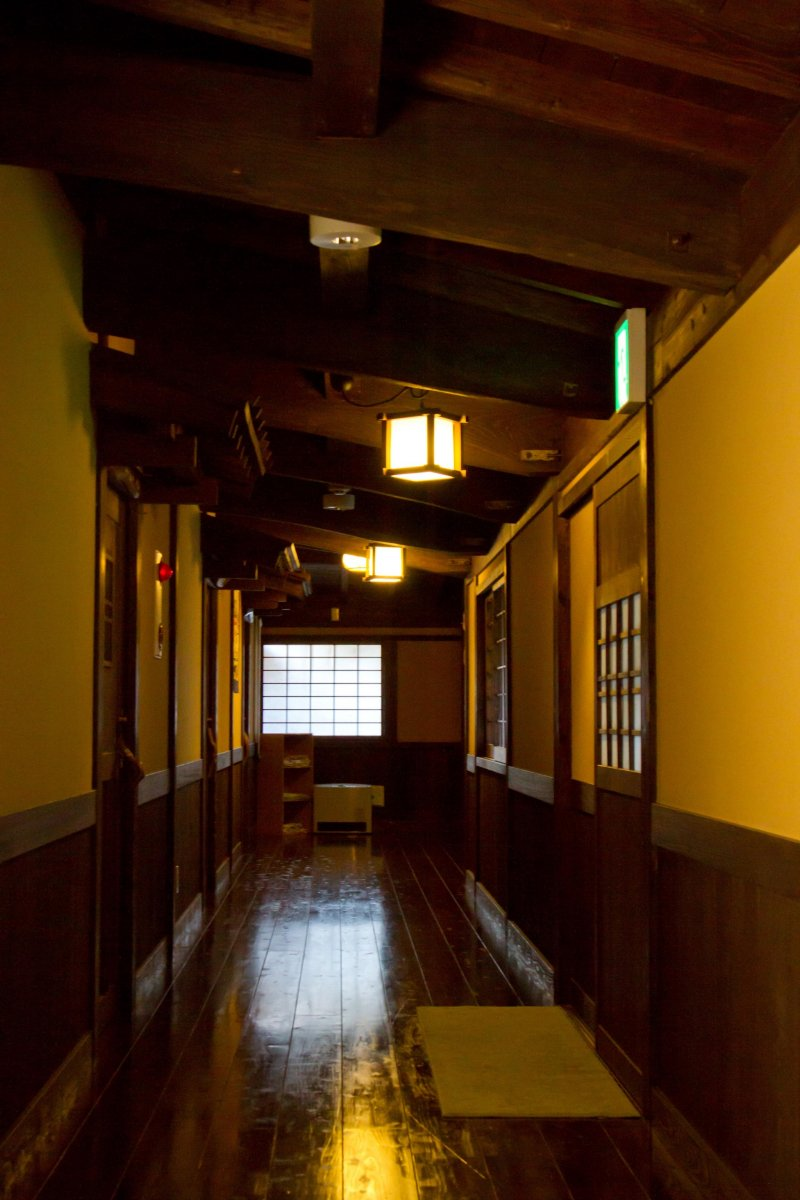 <p>The beautiful hallway between the main building and the rooms</p>