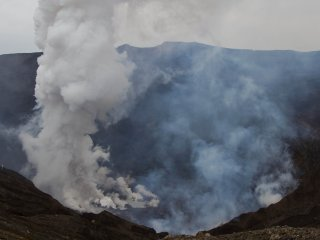 There is a parking lot pretty close to the crater rim, and on foot you can get even closer and have a look into the steaming caldera of Naka-dake.