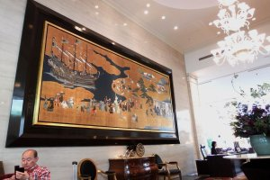 "In the lobby, a ceramic art ""Namban Screen"" mural is displayed on the wall. The original was painted by Naizen Kano before the 17th century (exact date unknown)"