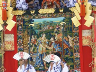 Gorgeous tapestries and brocades cover the floats