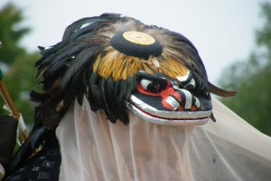This is the feathered headpiece of another group. Not all of them had antlers or menacing teeth.
