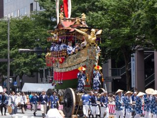 Fune-hoko (船鉾) During the Yamaboko Junko (山鉾巡行) in Kyoto, 2012! This float is based on a famous story about the legendary Empress Jingu of ancient Japan. After the death of her husband, and while pregnant with child, Empress Jingu armed herself and headed for war aboard a ship. This float as a whole is shaped like a boat and is enclosed with a vermilion parapet. On the front of the float is a mythical golden bird known as Geki