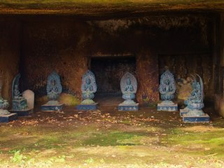 Statues in the caves on the right side approach to the temple