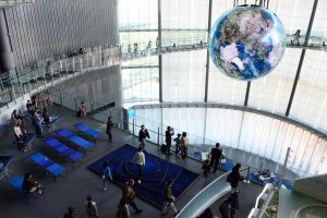 The giant globe floats between the two floors