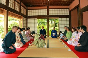 Lined up in rows, trying seiza seating style