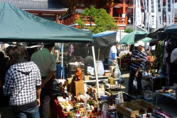 Various stalls make up the antiques fair below picturesque Osu Kannon